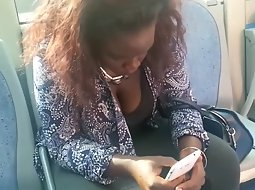 Big black girl texting on the bus