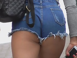Fit short girl with hot ass in booty shorts