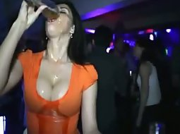 Drunk girl spills drink up her boobs