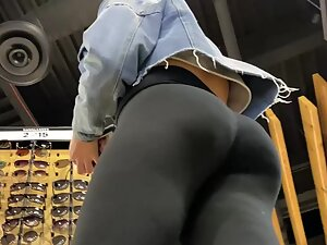 Hot ass of girl shopping for sunglasses