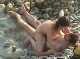 Hot woman rides a dick on the beach