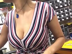 Helpful busty store clerk in shoe store