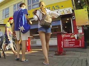 Leggy girl walks with a friend