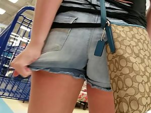 Shorts are jammed inside her tight ass crack