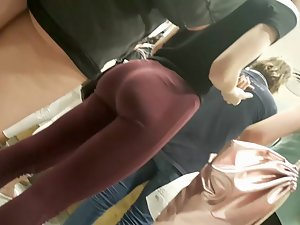 Mighty fine ass in dark red tights