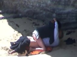 Couple banging on the beach
