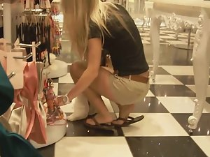 Blonde teen in shorts caught during shopping