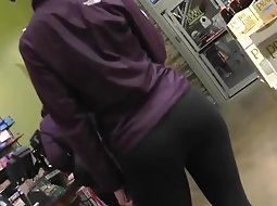 Amazing ass of a girl waiting in line