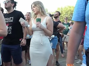 Curvy girl in tight white dress at a festival
