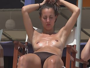 Sweaty topless girl with hot shaved armpits