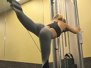 Fit and flexible girl does her gym workout