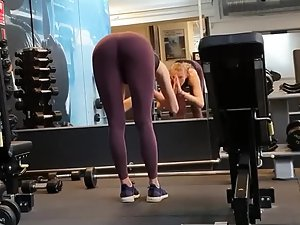 Sexy girl does fitness and yoga in the gym