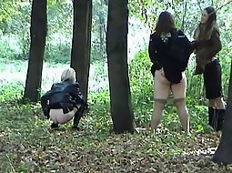 Group of girls pissing in the park