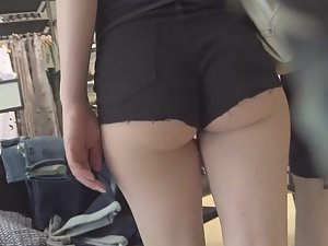 Perfect ass squeezed inside black shorts