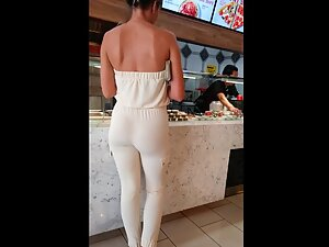 Gentle girl with hot bubble butt in a restaurant