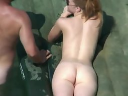 Naked ginger girl at a beach