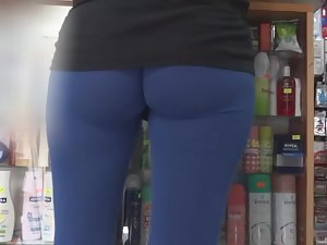 Insane blue tights show off each buttock