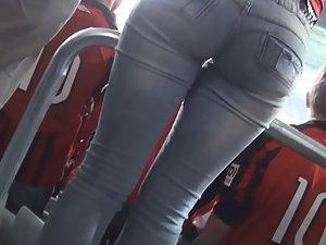 Sexy football fan in tight jeans