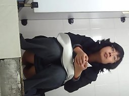 Chinese milf spied while pissing