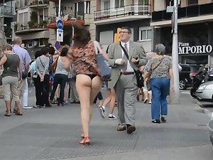 Accidental upskirt reveals ass and thong