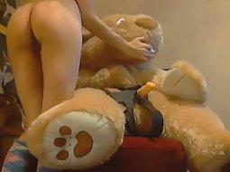 Cam girl fucks her teddy bear