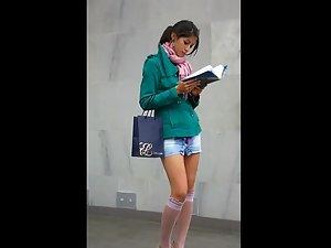 Upskirt of stylish girl in public transport