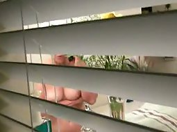 Naked in her bathroom