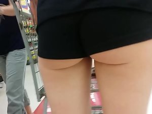 Hot ass in shorts and mismatched socks