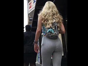 Curly blonde walks in a very sexy manner