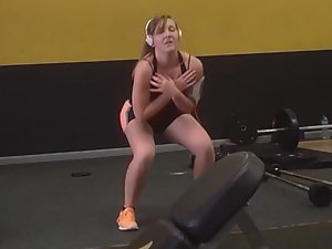 Cute girl is visibly new to the gym