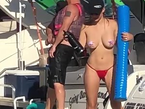 Busty slut twerks and flashes tits on boat party