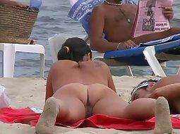 Examining a cute nudist couple