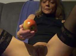 Mature wife puts an apple in her ass