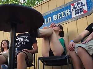 Teen girl exposes ass when she sits with legs on table