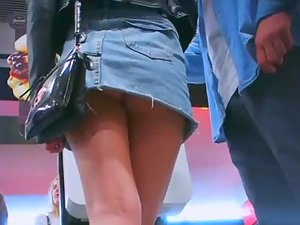 Meaty buttocks under short denim skirt
