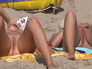 Nudist girls eating oranges and suntanning