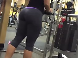 Muscular girl's ass in the gym