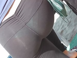 Green thong seen through leggings