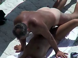 horny couple on the beach