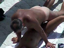 horny couple on the beach