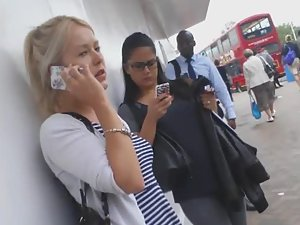 Upskirt peep of hot blonde during phone talk