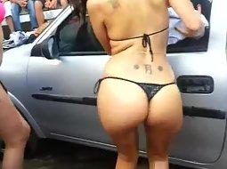 Bikini girls washing a car