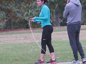 Busty milf jumping rope in the park