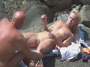 Nudist woman stepped on a sea urchin