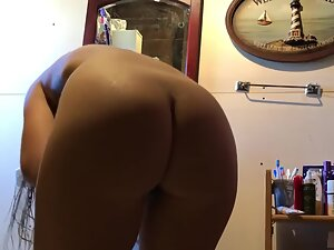 Bent over and drying hair in front of hidden camera