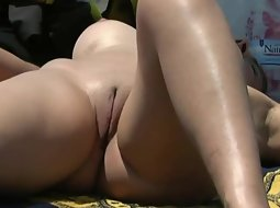 Smooth beefy pussy at the beach