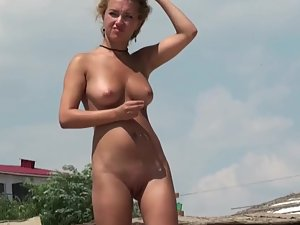 Lusting after beautiful naked blonde on beach