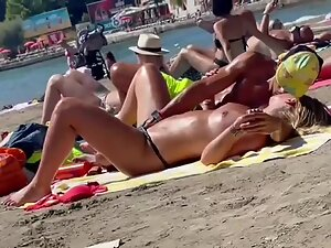 Kissing and fingering pussy caught on a regular beach