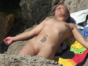 Naked lesbians relaxing and soaking in the sun