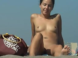 Nudist friends on the beach